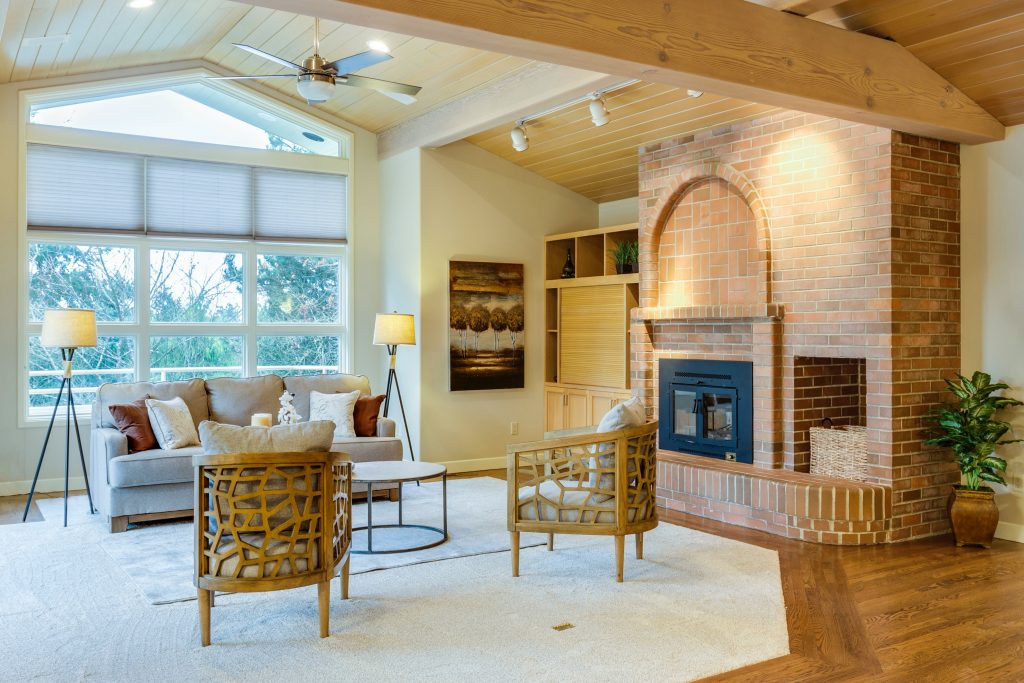a well home-staged living room with well-lit interiors and themed furniture